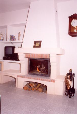 Piedra Rosa Sepúlveda combinada con ladrillo visto.
